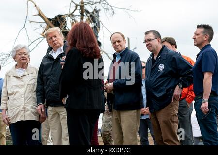 Opelika, Alabama, USA. 08th March, 2019. U.S President Donald Trump surveys damage and meets with residents along with Alabama Gov. Kay Ivey, left, and Senator Richard Shelby, center, March 8, 2019 in Opelika, Alabama. The region was hit by a tornado on March 3rd killing 23 people. Credit: Planetpix/Alamy Live News - Stock Image