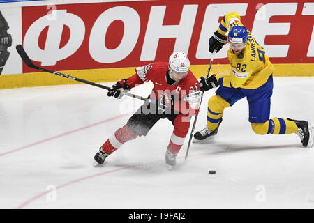 Bratislava, Slovakia. 18th May, 2019. From left RAPHAEL DIAZ of Switzerland and GABRIEL LANDESKOG of Sweden in action during the match Sweden against Switzerland within the 2019 IIHF World Championship in Bratislava, Slovakia, on May 18, 2019. Credit: Vit Simanek/CTK Photo/Alamy Live News - Stock Image