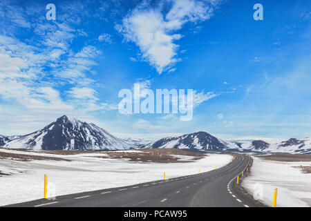 The Iceland Ring Road in North Iceland, passing through dramatic mountain scenery. - Stock Image