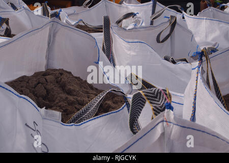 A view looking across the tops of a group of full, white hippo bags with gritty soil inside - Stock Image