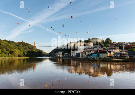 Balloons Drift Over the Clifton Suspension Bridge During the Bristol Balloon Fiesta, 2018 - Stock Image