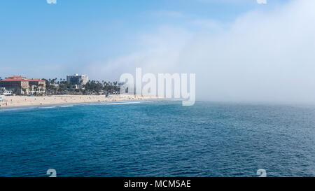 Peculiar weather change with sudden fog drifting fast towards the Venice Beach and Santa Monica Beach, Los Angeles, California, USA - Stock Image