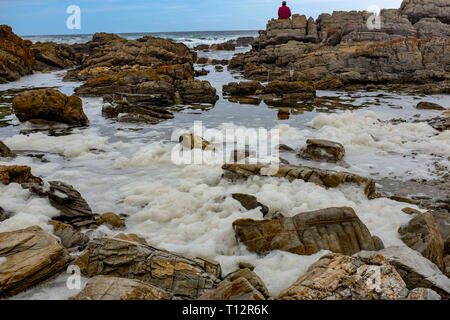 A view of foamy waves in the Indian ocean along the Otter Trail, South Africa's most famous and beautiful hiking trail in the Western Cape - Stock Image