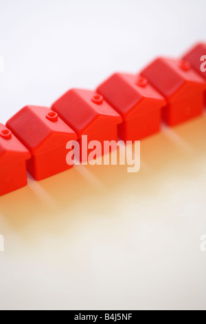 Row of red monopoly hotels - Stock Image