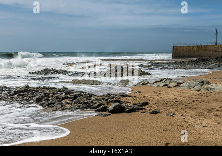 The beach at Porthleven in Cornwall on a windy day in April with nobody on the beach - Stock Image