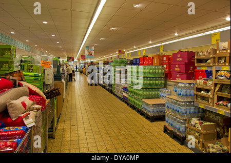 Isles of Aldi with pallets of soft drinks and their central area of odds and ends specials - Stock Image