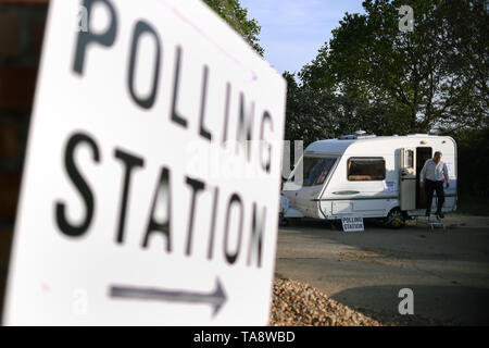 A man leaves after casting his vote in a caravan being used as a polling station on a farm in Garthorpe near Melton Mowbray, in Leicestershire, as voters head to the polls for the European Parliament election. - Stock Image