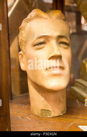 Male human head face antique cast mannequin, inside antiques centre, Marlesford Mill, Suffolk, England, UK - Stock Image