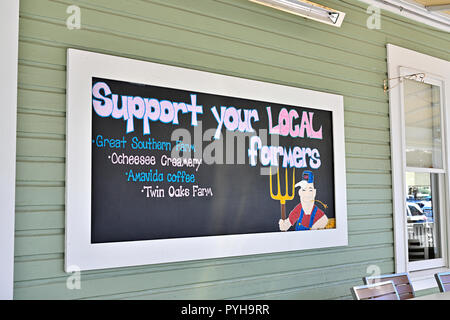 Support your local farmers wall sign promoting local food sources in Seaside Florida, USA. - Stock Image