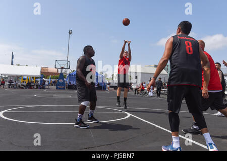 Coast Guard Ensign Sean Stickney, assigned to Sector Los Angeles-Long Beach shots a wide-open shot against Team Busciano in the 2018 Los Angeles Fleet Week 5-on-5 Basketball tournament in San Pedro, California, September 1st, 2018. Team Coast Guard 1 defeated Team Busciano 45-37 to advance to semifinals of the tournament. U.S. Coast Guard photo by Petty Officer 3rd Class DaVonte' Marrow. - Stock Image