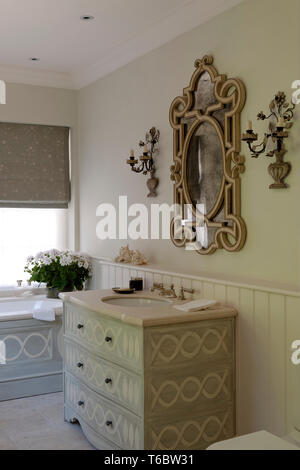 Ornate mirror and candle holders in bathroom - Stock Image