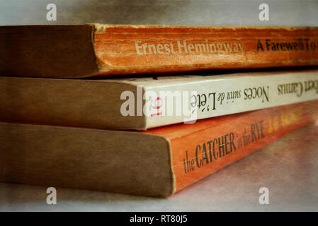A pile of paperback books - Stock Image