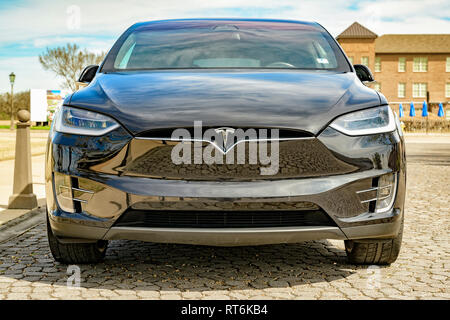 Black Tesla Model X electric car parked on a city street in Montgomery Alabama, USA. - Stock Image