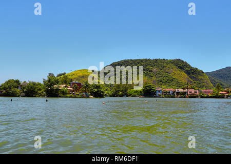 Pantanal Carioca. Houses along the river.  Barra da Tijuca canal. Rio de Janeiro. Brazil - Stock Image