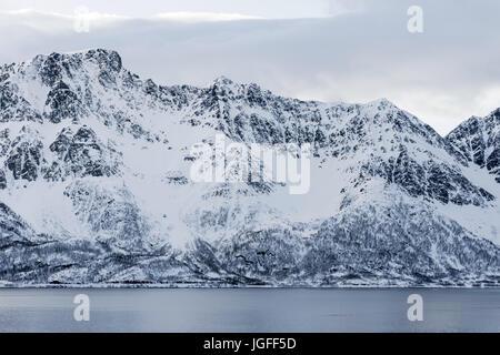 Mountainous coastal view at Øksfjord, Finnmark County, Norway. - Stock Image