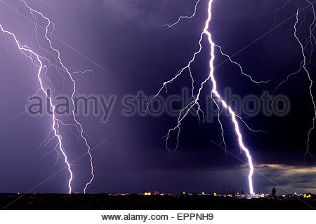Huge Lightning Bolt hitting telephone pole in neighborhood, in an unusual winter storm, with lightning and hail. - Stock Image