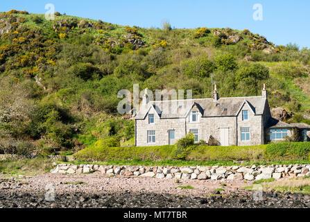 Stone cottage on the shoreline at Rockcliffe, Dumfries and Galloway, Scotland, UK - Stock Image