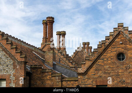 The roofline of the Ancient House, Holkham, Norfolk, UK; with ornate chimneys and stepped gables - Stock Image