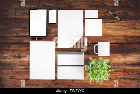 top view of devices and branding elements on wood desktop mockup 3d rendering - Stock Image