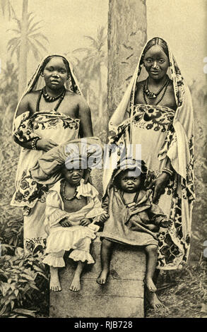 Two young Swahili women and children of East Africa (then part of the British Empire). - Stock Image