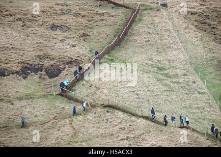 Tourist walking on mountain - Stock Image