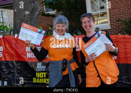 Volunteers with the political lobbying group, GetUp, handing out how to vote leaflets at a polling booth in West Hobart on election day, May 18 2019. - Stock Image