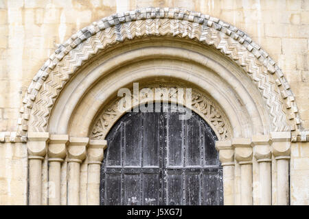 Intricate stone arch above a door on the south side of the medieval christian cathedral at Peterborough, England. - Stock Image