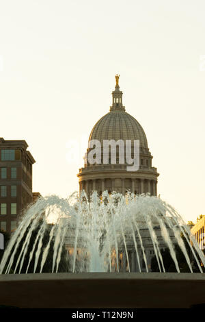 A fountain outside the Wisconsin State Capitol at sunset, Madison, Wisconsin. - Stock Image