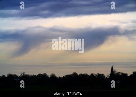 Rain falling above a church spire, Fletching, East Sussex, UK - Stock Image