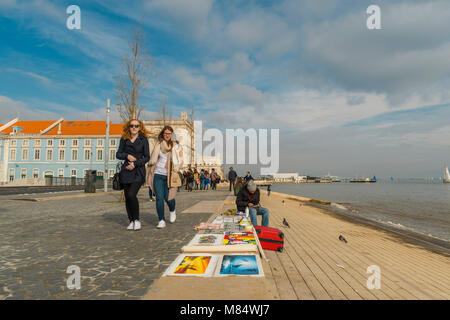 LISBON / PORTUGAL - FEBRUARY 17 2018: PEOPLE WALKING ALONG OCEAN IN CITY OF LISBON - Stock Image