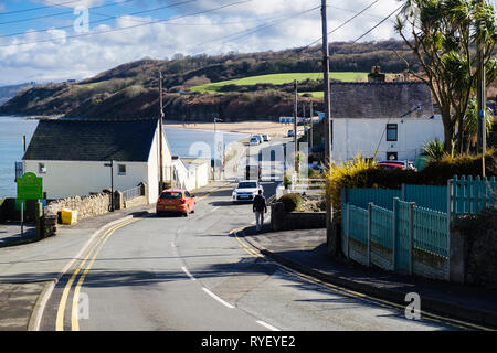 View down road to seafront and beach in village resort of Benllech, Isle of Anglesey, North Wales, UK, Britain - Stock Image