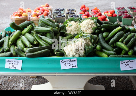 Variety of vegetables and fruit for sale at farm stand - Stock Image