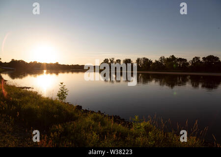 The River Elbe at Dessau, in Saxony Anhalt, Germany. The waterway is seen in summertime. - Stock Image