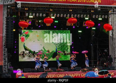 London, UK, 10 February, 2019. Chinese New year celebration at Trafalgar square , London, UK. Group perfromance by Chinese females on stage. Credit: Harishkumar Shah/Alamy Live News - Stock Image