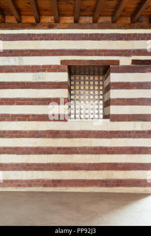 Background of old wall with red bricks and yellow stones, Cairo, Egypt - Stock Image