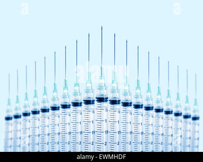 Stock image of syringes in formation. Focus on front syringe. - Stock Image