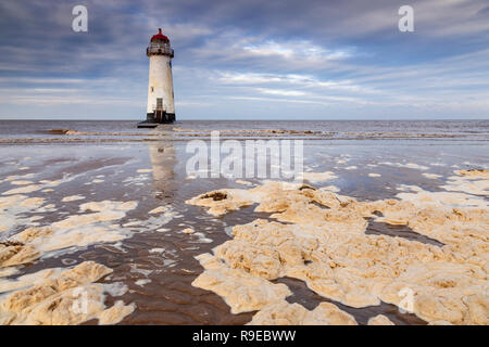 Point of Ayr lighthouse with pollution on Talacre beach, North Wales - Stock Image