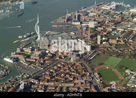 Aerial view of Gunwharf Quays Shopping Centre, the Spinnaker Tower and Portsmouth Harbour Railway Station - Stock Image