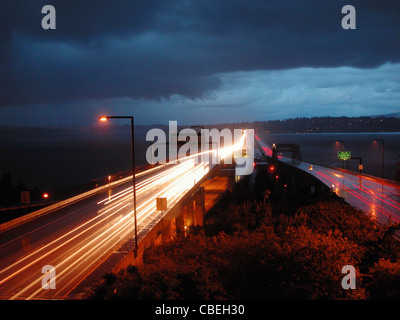 I-90 Floating Bridge at dusk with storm clouds rolling in. - Stock Image
