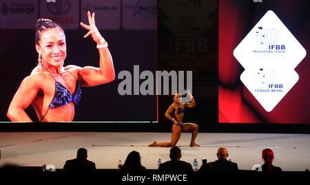 Kathmandu, Nepal. 16th Feb, 2019. A female participant poses during Pro Qualifier tournament of International Federation of BodyBuilding and Fitness (IFBB) Professional League in Kathmandu, Nepal, Feb. 16, 2019. Credit: Sunil Sharma/Xinhua/Alamy Live News - Stock Image