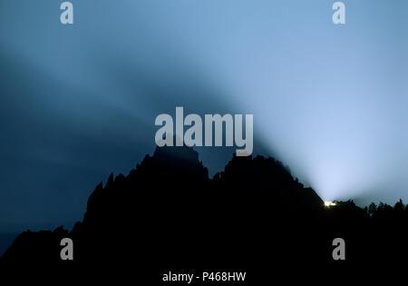 Sunbeams at sunrise behind the Aiguille de Grepon, Chamonix. France - Stock Image