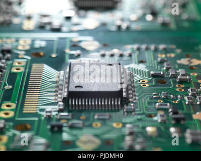 Electronic chip and components on a circuit board - Stock Image