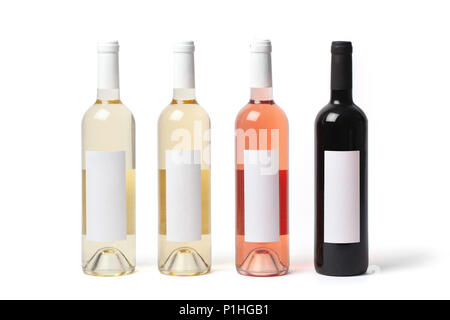 Four bottles with different kinds of wine, white, rose and red isolated on white background. - Stock Image
