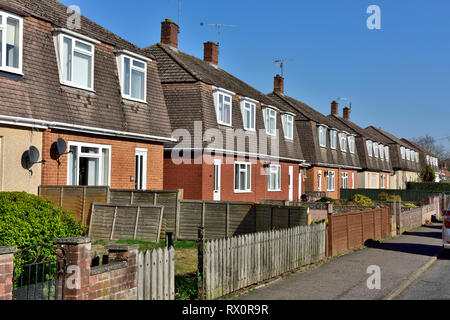 Row of modern two story semi-detached houses in Tiverton, Devon with dormer windows in mansard roofs - Stock Image