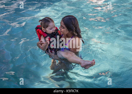 2, two, Hispanic girls, sisters, playing in swimming pool, swimming pool, fresh water swimming pool, Castro Valley, - Stock Image