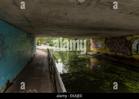 Under a road bridge on the canal - Stock Image