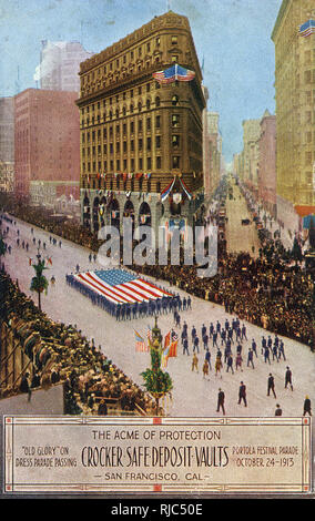 'Old Glory' (The Star and Stripes Flag) on dress parade passing 'The Acme of Protection' Crocker Safe Deposit Vaults, San Francisco, California during the Portola Festival Parade on 24th October, 1913. - Stock Image