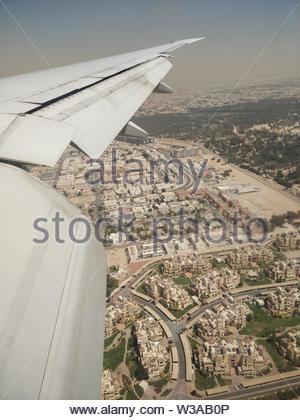 aerial view from an airplane of its wing - Stock Image