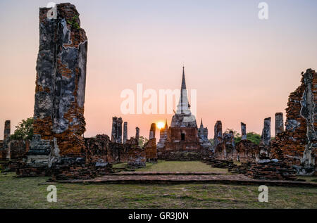 Ruins and pagoda ancient architecture of Wat Phra Si Sanphet old temple famous attractions during sunset at Ayutthaya, - Stock Image