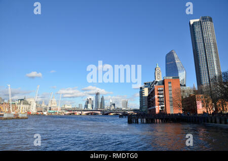 A view of the river Thames looking east from Southbank. The OXO tower is to the right with the City of London skyline in the distance - Stock Image